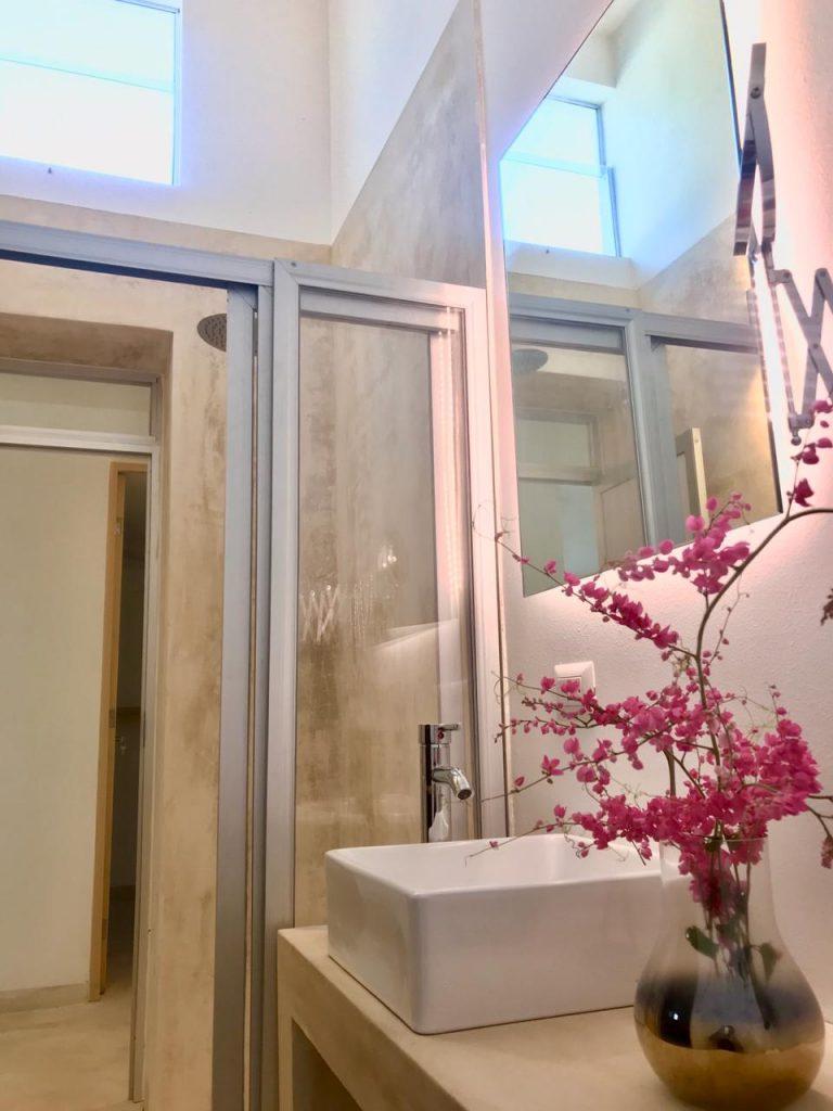 Pink flowers in bathroom